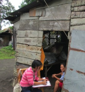 Dona (community based rehab worker) collecting household survey data in Ligao City.