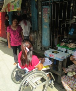 Pia (from WOWLEAP) collecting household survey data in Quezon City.